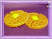 two waffles with butter on top